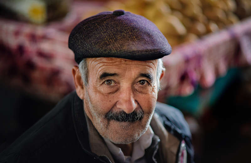 elderly man looking at the camera