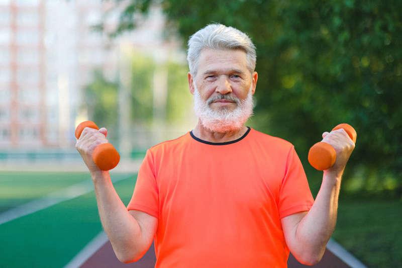 elderly man exercising outside